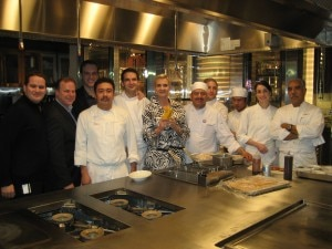 Sophie Gayot with chef Sebastian Archambault, his team, and general manager Michel Morauw