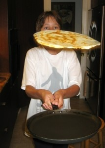 Kids love to flip the crêpe in the pan