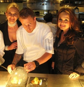 Chef Michael Voltaggio smoking salmon with TV star chef Giada di Laurentiis and Sophie Gayot