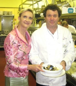Chef Jean-François Meteigner presenting his whitefish to Sophie Gayot