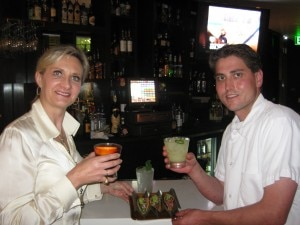 Chef Nick Albrecht and Sophie Gayot toasting over tuna ceviche tacos