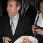 Daniel Boulud serving food in the basement of Bar Boulud at an after party