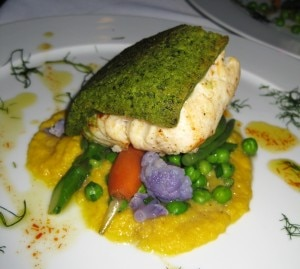 Kevin Meehan's herb-crusted halibut on a bed of corn purée and spring vegetables