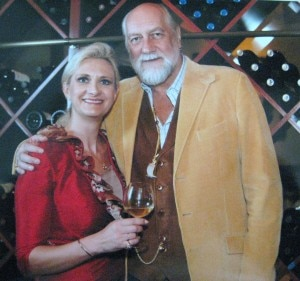 sophiegayotmickfleetwood 300x281 Mick Fleetwood and Sophie Gayot with a glass of 2005 Mick Fleetwood Private Cellar Reisling