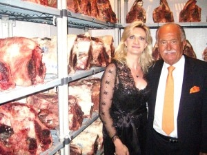 Wolfgang Zwiener showing Sophie Gayot his custom designed meat aging fridge