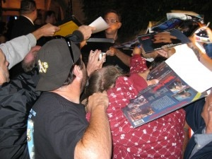 Tom Hanks signing autographs to his fans
