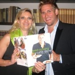 Chef Curtis Stone showing his new book to Sophie Gayot