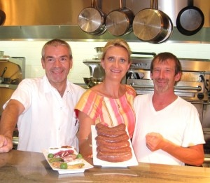 Chef Bruno Herve-Commereuc and his boudin noir (right), with chef de cuisine Hugues Quintard and Sophie Gayot