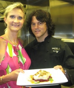 Chef Kerry Simon with Sophie Gayot in the kitchen of Simon L.A.