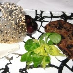 Cheese plate, served with cherries and a delicious homemade crunchy nut bread