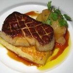 Caramelized foie gras on a French toast brioche, accompanied with a poached white peach in a vanilla verjus gastrique