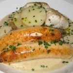 Seafood sauerkraut with salmon sausages