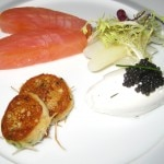 Smoked salmon and its light potato blini, paired with American caviar