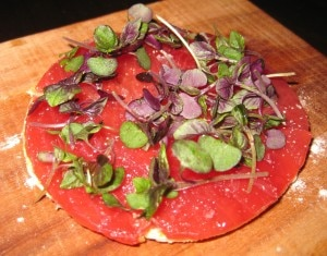tunabondstbeverlyhills 300x235 Big eye tuna on a crispy tart with white truffle oil served on a plate made of wood