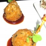 Frogs' legs lollipops with house barbeque coulis