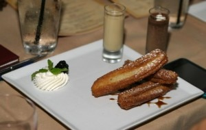 House-made churros with KAHLÚA Especial reduction and KAHLÚA Coffee Cream dipping sauce