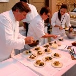 Chef Norman Van Aken preparing potato inspired dishes