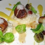 Hokkaido scallops with Spanish rice and brussel sprouts