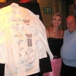 Robin Leach getting ready to auction the six chefs' jackets