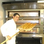 Baker Jeffrey Lapointe getting from bread out for the guests