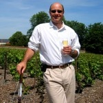 Alain Gayot sipping Clos du Mesnil in the Clos du Mesnil Vineyard