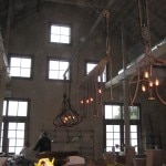 Chandeliers constructed from old farm equipment