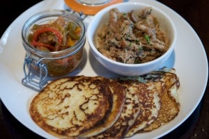 Johnny cakes with Gunthorp Farm pork and chow chow are on the menu at The Southern. Photo courtesy of J. Lasky.