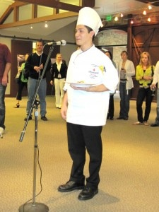 Luis Young presenting his dish to the judges