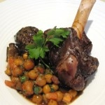 Braised Colorado lamb shank with chick peas, grilled eggplant and tomato-pomegranate molasses