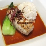 Char grilled mahi mahi with stir fried bok choy, steamed rice and lobster lemon grass reduction