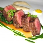 Peppered New York steak, quail egg, grits soubise, wilted spinach and herb emulsion