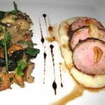Prime pork tenderloin crepinette with wild mushrooms, roasted garlic, potato purée and roasted garlic jus