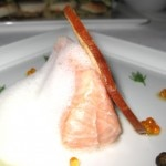 Slow roasted Tasmanian salmon with hedgehog mushrooms, pearl onions and smoked white bean puree
