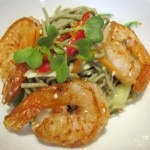 Chilled soba noodle salad with crunchy sesame-garlic prawns, bean sprouts, peanuts, cilantro and lemon soy dressing