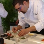 Chef Juan Andrés R. Morilla creating an apple dessert with molecular products and virgin olive oil