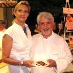 Chef Celestino Drago, from Drago, Santa Monica, CA, over a pork sausage with Sophie Gayot