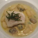 John Dory fillet poached in Malabar black pepper-citrus butter with cannelloni beans, marin velouté