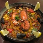 Mix Paella with lobster, chicken, chorizo, vegetables and saffron rice