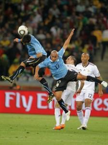 Egidio Arevalo Rios and Mauricio Victorino of Uruguay challenge Franck Ribery of France