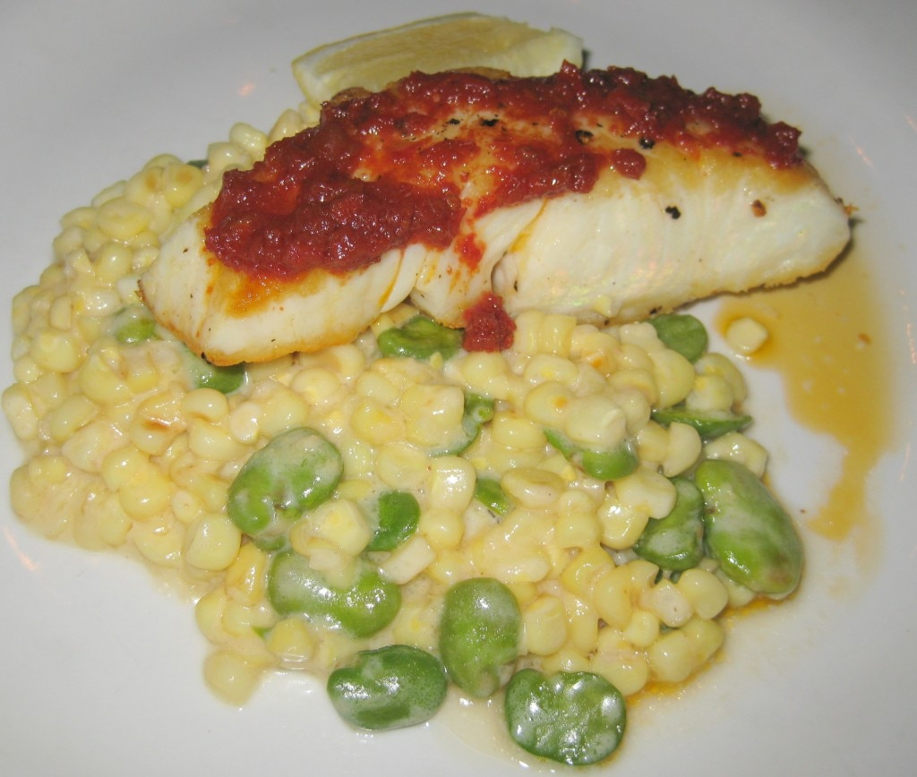 Wild Alaskan halibut with creamy spring corn and fava bean succotash with smoked tomato vinaigrette
