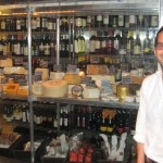 General manager Jason Berkowitz in front of the cheese display