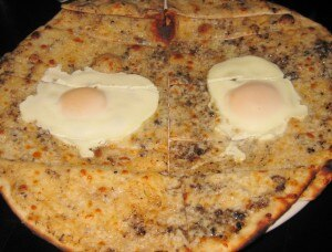 Black truffle pizze with mozzarella and fried egg