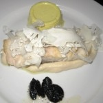 Wild striped bass with cauliflower, black garlic and yellow panna cotta