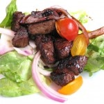 Shaken beef with carmelized red onions and over butter lettuce