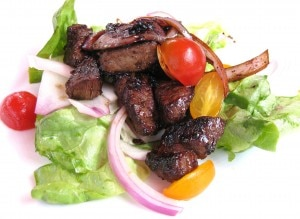 tiatobeefsalad 300x219 Shaken beef with carmelized red onions and over butter lettuce