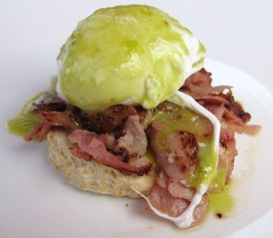 Green eggs & ham benedict with house baked ham, biscuit and chive hollandaise