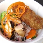 Traditional Vietnamese rice noodle salad with lemon grass chicken and chicken rice crispy rolls
