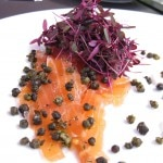 Cured salmon carpaccio with fried capers, horseradish crème fraiche and garden herbs