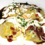 Braised beef lengua ravioli with spiced lebni, toasted pine nuts and dry chile