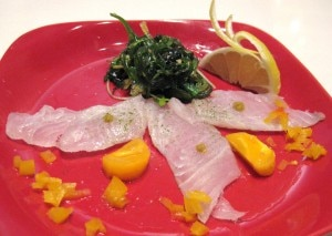 Sashimi garden salad; halibut sashimi sprinkled in green tea sea salt and lemon